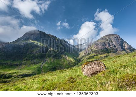 Clouds on Blue Sky Capped Summit of Scottish Highlands