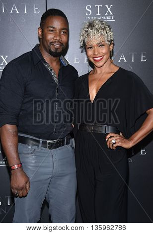 LOS ANGELES - JUN 21:  Michael Jai White & Gillian Iliana Waters arrives to the