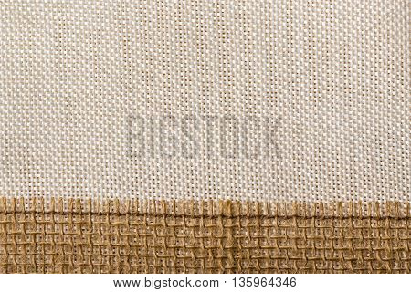 Jute bagging ribbon on bright textile material sack cloth background
