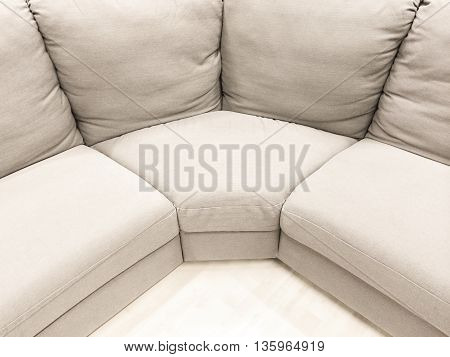 Luxurious white corner sofa. Modern style furniture.