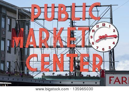 SEATTLE USA - JUNE 15 2016: The bright red public market sign marks the main entrance to Seattle's famous Pike Place Market.