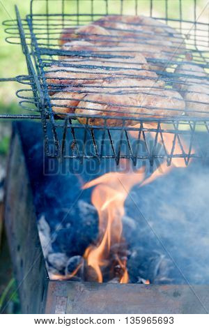 Delicious sausages made of natural meat. Prepared in the lattice in the fire.