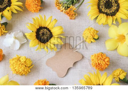Brown Tag On Yellow Flowers Summer Background