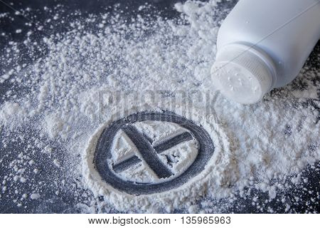 Talcum Powder With Cross Sign On Black Background