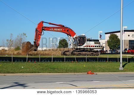 NAPERVILLE, ILLINOIS / UNITED STATES - NOVEMBER 3, 2015: A Link-Belt 330LX hydraulic excavator, owned by J.S. Riemer, is ready to dig in Naperville.