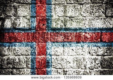 Faroe islands flag on steel wall texture background