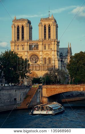 PARIS, FRANCE - MAY 13: Notre Dame de Paris cathedral with River Seine at sunset on May 13, 2015 in Paris. With the population of 2M, Paris is the capital and most-populous city of France