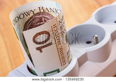 Rolls Of Polish Currency Money In Electrical Power Strip, Energy Costs