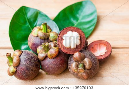 The Mangosteen On Rustic Wooden Table. Local Fruit Of Thailand