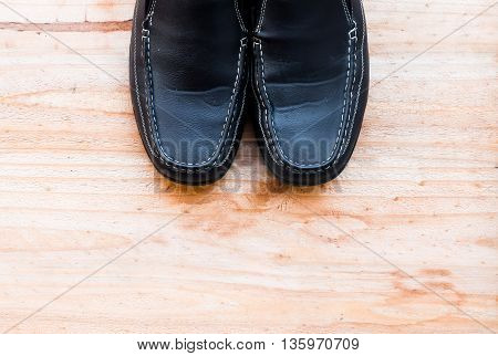 Man's collection: tie shoes on a wooden background
