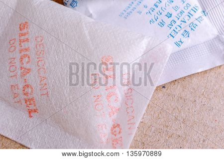 Close Up Silica Gel Or Desiccant In Paper Bag Background