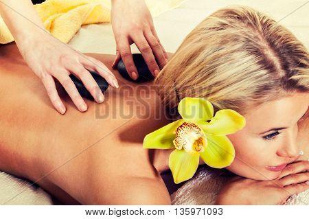 Stone Massage, Woman Getting A Hot Stone Massage At Spa Salon