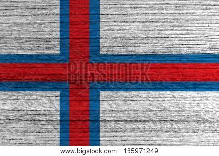 Faroe Islands flag painted on wood background