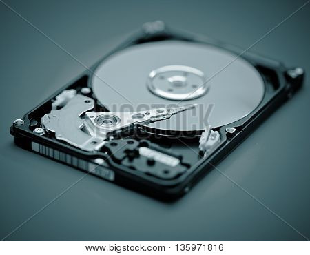Open hdd device close up. Blue colored image
