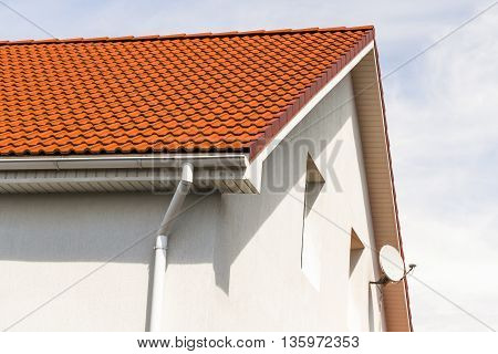 The upper part of the house. Roof inspection windows chimney.