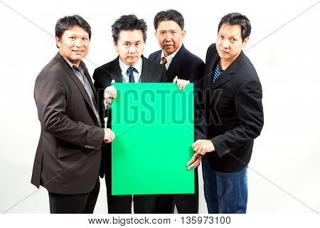 Team of Businessmen holding a blank green banner