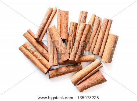 Pile of Cinnamon sticks on white background