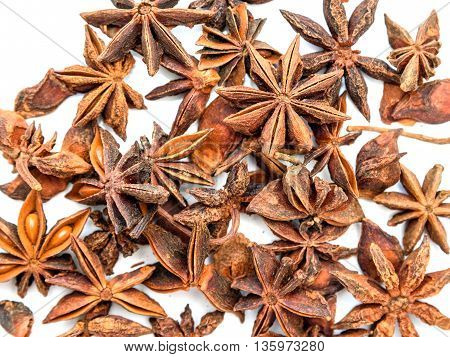 Top view of Anise stars on white background. Texture