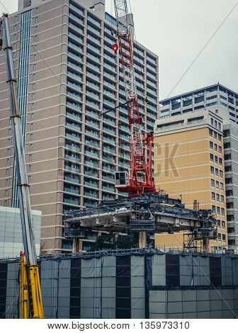 Tokyo Japan - February 26 2015: Building crane on a construction site in Tokyo