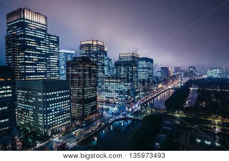 Tokyo Japan - February 26 2015: Night view on Marunouchi commercial dsitrict with Shin Marunouchi Marine Nichido Nippon Yusen Mitsubishi Shoji buildings