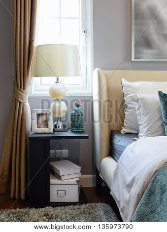 Bedroom Interior Design With White And Green Pillows On White Bed And Decorative Table Lamp.
