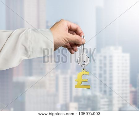 Hand Holding Silver Key With Golden Pound Symbol Shape Keyring, 3D Rendering