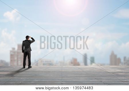 Businessman Rear View Gazing At City On Old Wooden Floor