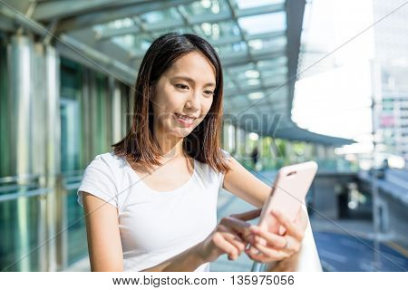 Woman sending sms on cellphone