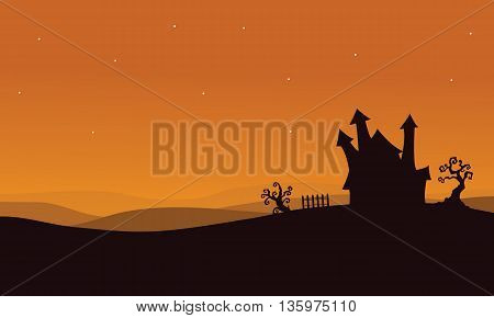 Silhouette of Halloween scary house with orange backgrounds