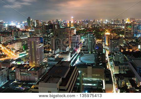 Aerial view of Bangkok city at night. Modern asian megalopolis cityscape at night