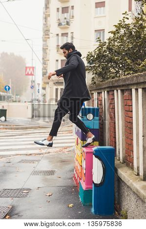 Handsome Indian Man Jumping In An Urban Context