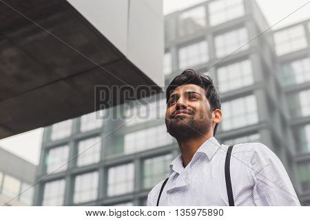 Handsome Indian Man Posing In An Urban Context