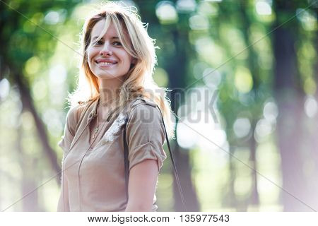 Outdoor portrait of a beautiful girl. Soft focus. Natural light and sunflare.