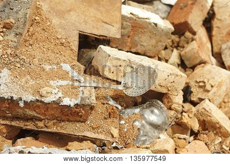 used skimmer perforated spoon on old brick close up