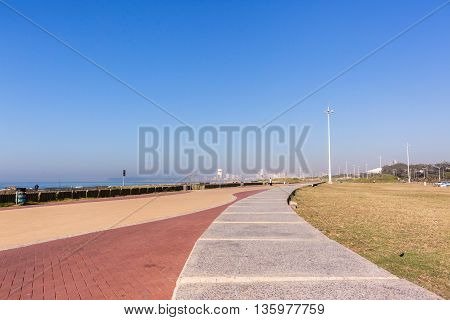 Beachfront ocean blue sky promenade landscape at umgeni river mouth Durban South-Africa.