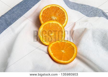 Juicy half of orange and orange slices