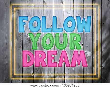 inspirational quote follow your dream on wood background