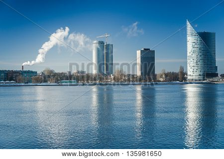 A view of the buildings on the banks of the Daugava River in Riga, Latvia at winter