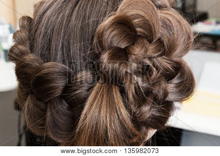 weave beautiful braids in a hairdressing salon