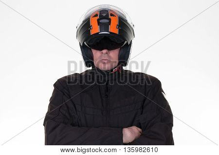 Macho Motorcycle Rider Posing While Wearing His Jacket,