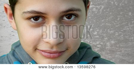 Young boy on rainy street