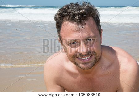 Smiling Handsome Man With No Shirt Posing At The Sea