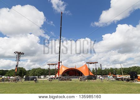 Roskilde, Denmark - June 26, 2016: The orange stage under construction for Roskilde Festival 2016