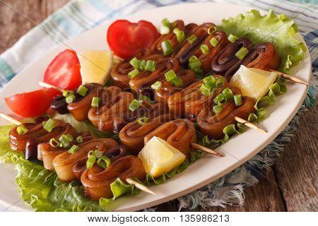 Calamari Rings On Skewers With Lemon And Vegetables Closeup. Horizontal