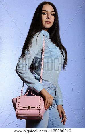 Attractive Woman In Jeans With A Pink Bag