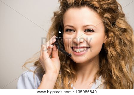 Portrait of a smiling woman wearing an headset