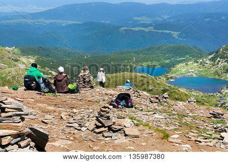 Rila, Bulgaria - June 22, 2016: People watching Seven Rila Lakes in National Park Rila, Bulgaria