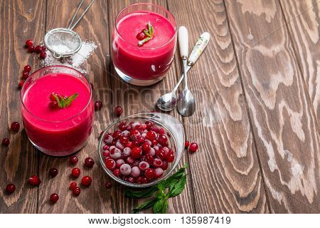 cranberry mousse with semolina on dark wooden background, top view
