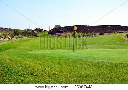 Part Of Green Golf Grass Field With Flag