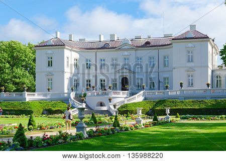 PALANGA LITHUANIA - JULY 12 2015: Unidentified people are relaxing near Amber Museum (former palace of Tyszkiewicz) in Botanical Park in popular resort town of Palanga Lithuania